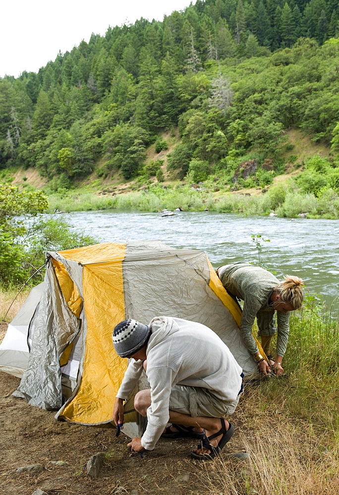 Couple preparing campsite