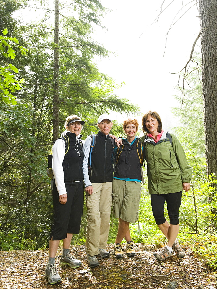 Female hikers posing in forest