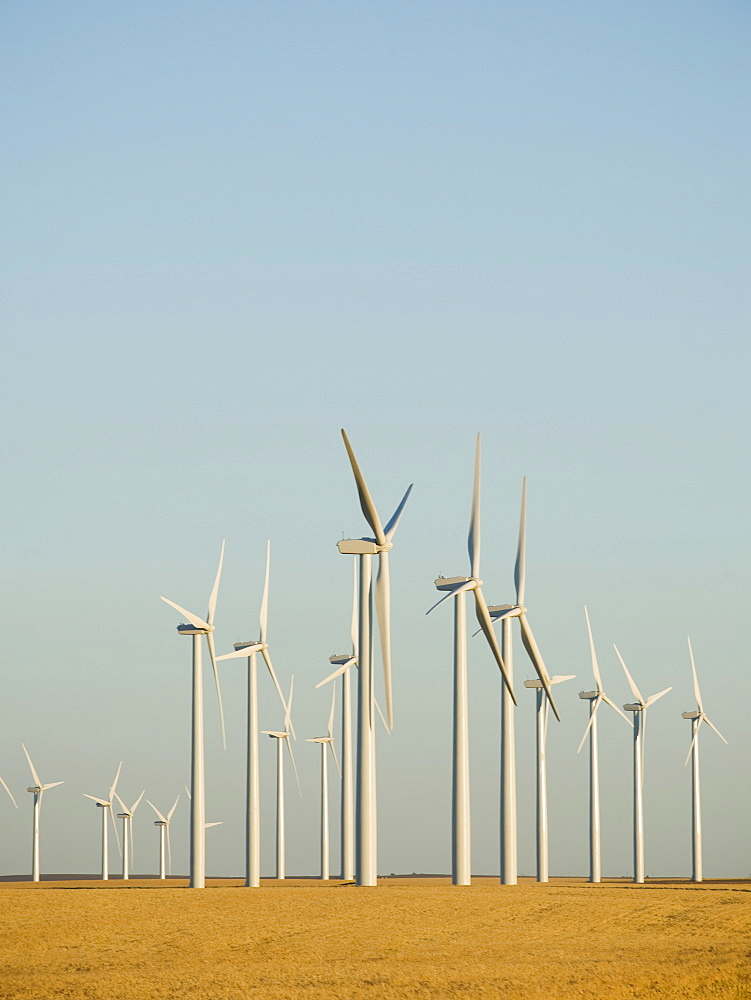 Rows of windmills on wind farm
