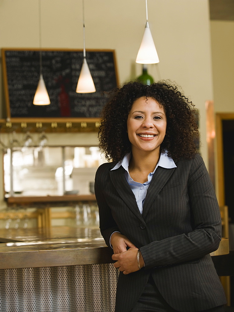 Businesswoman posing in restaurant