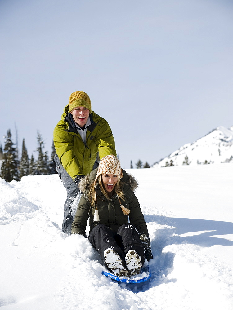 A couple sledding