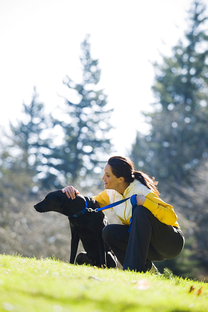 A woman with a dog outdoors