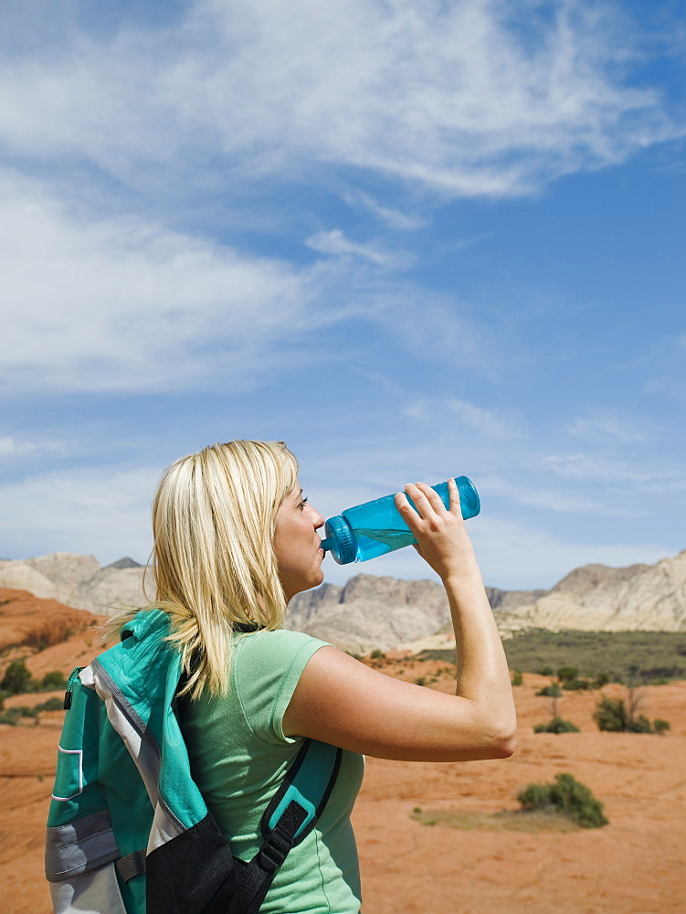 A woman at Red Rock drinking water
