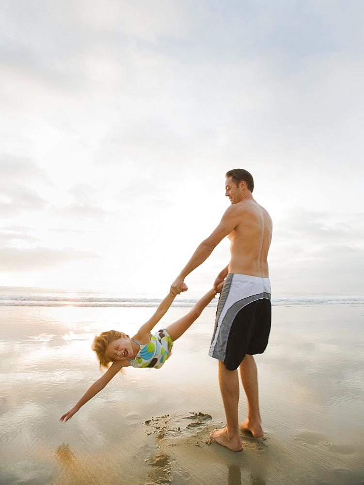 Man swinging girl