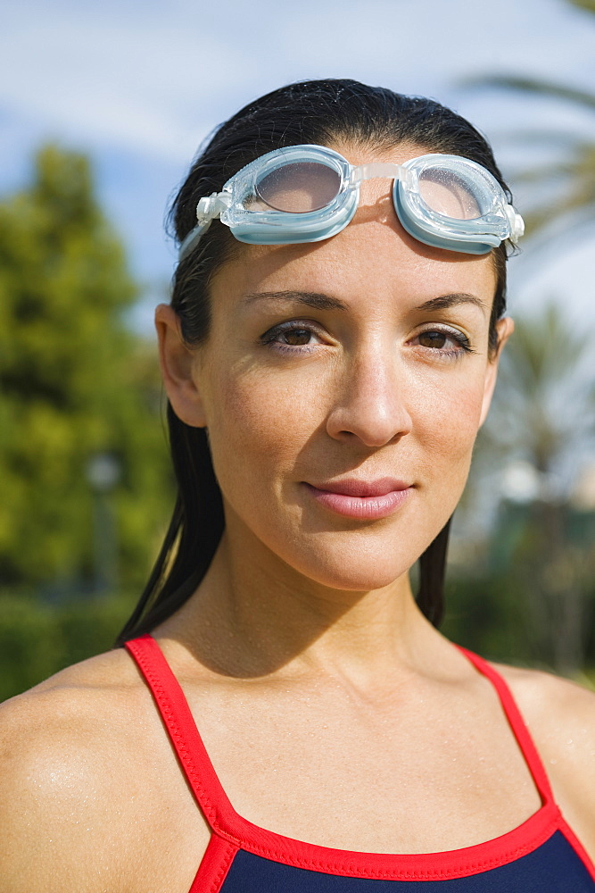 Woman wearing swimming goggles