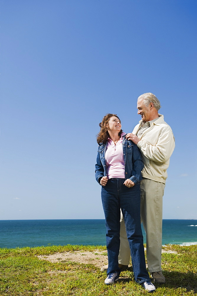 Couple standing near the ocean