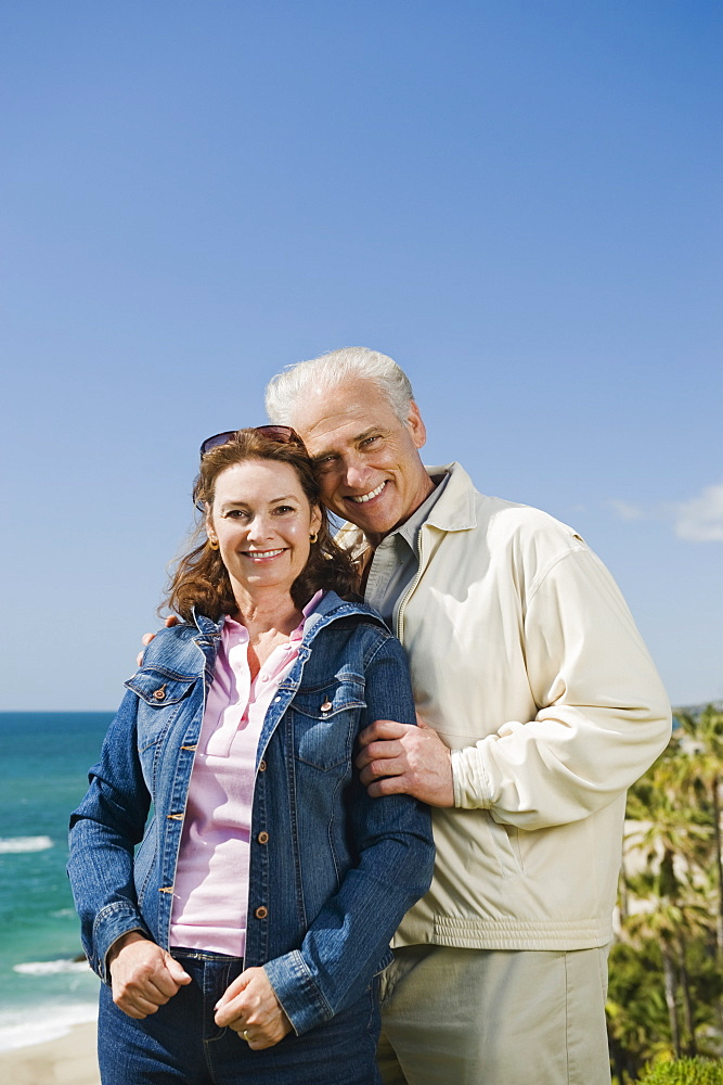 Portrait of a couple by the beach