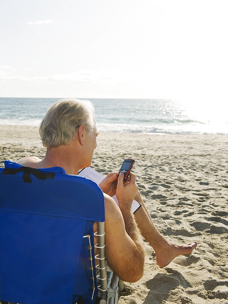 Man relaxing in beach chair