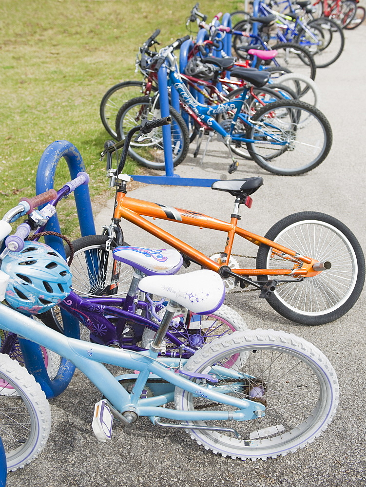 Row of children's bicycles locked up in school yard