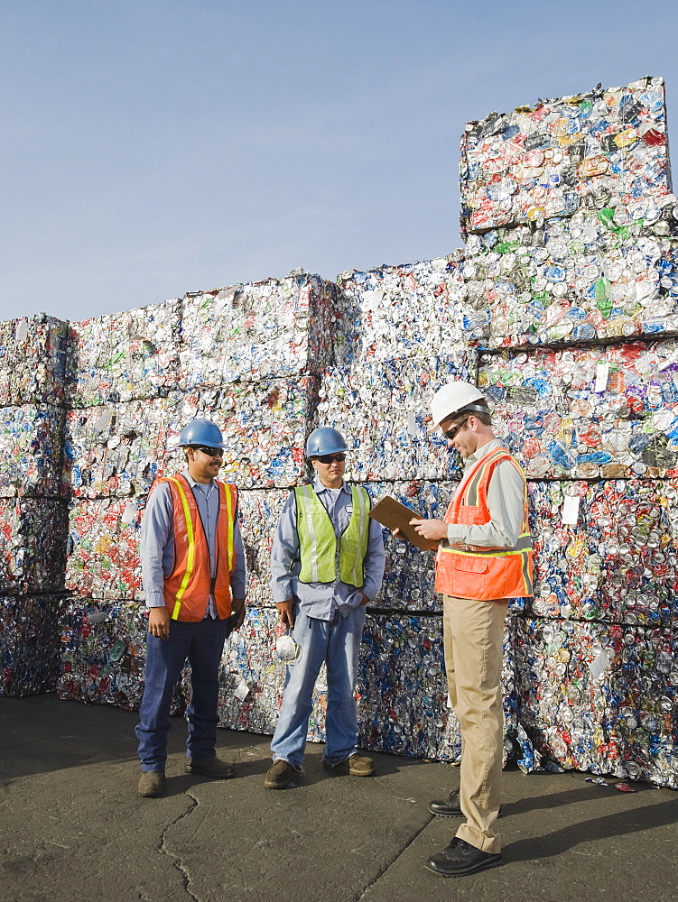Workers at recycling plant