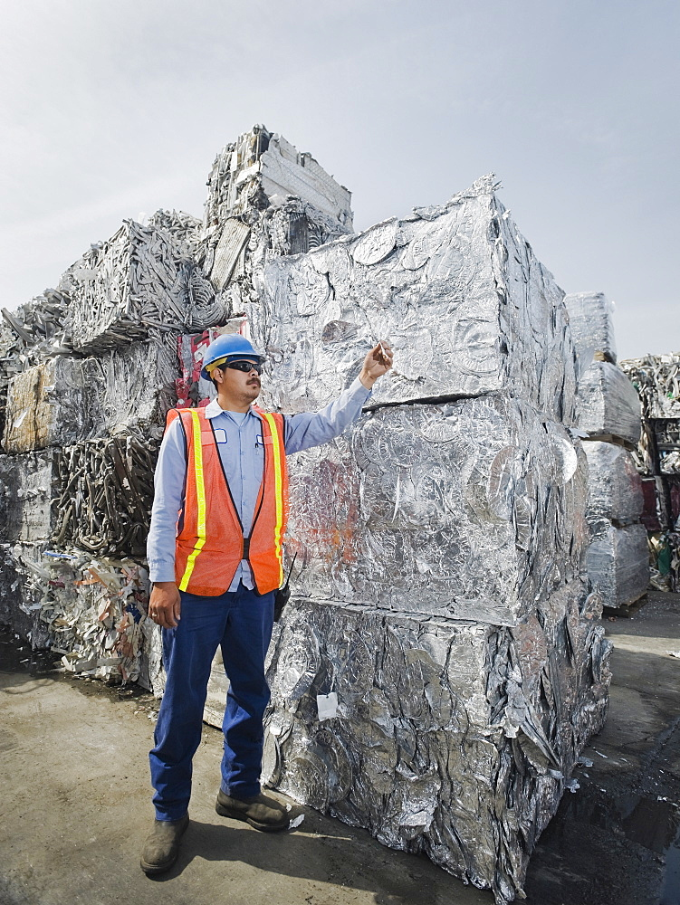 Worker at recycling plant