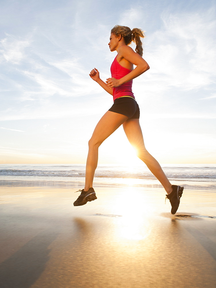 USA, California, Los Angeles, woman jogging on beach
