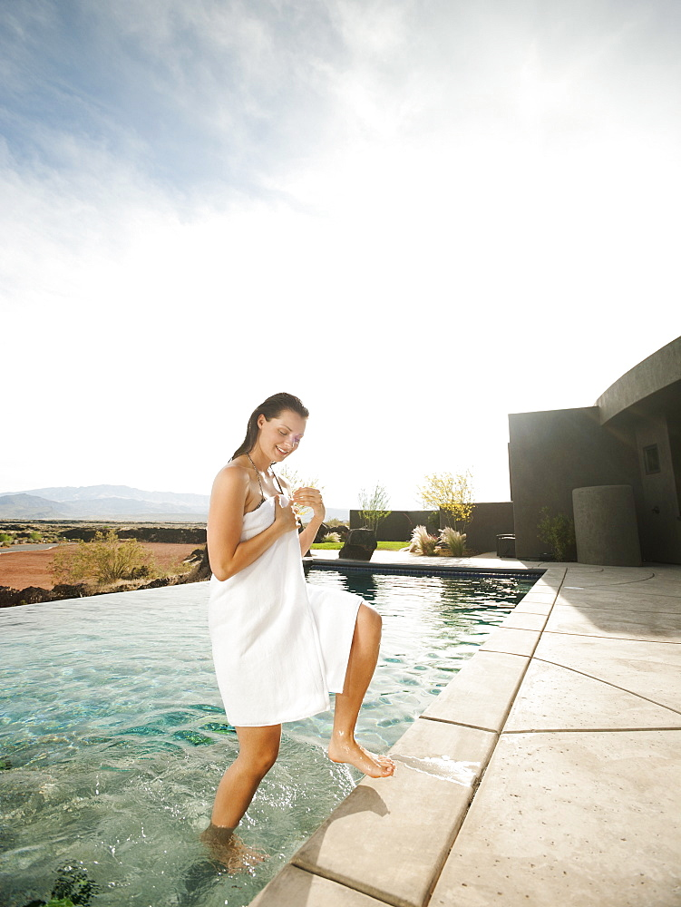 Young attractive woman emerging from swimming pool, USA, Utah, St. George