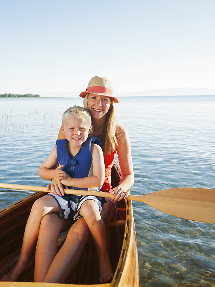Portrait of young woman with son (4-5) canoe traveling