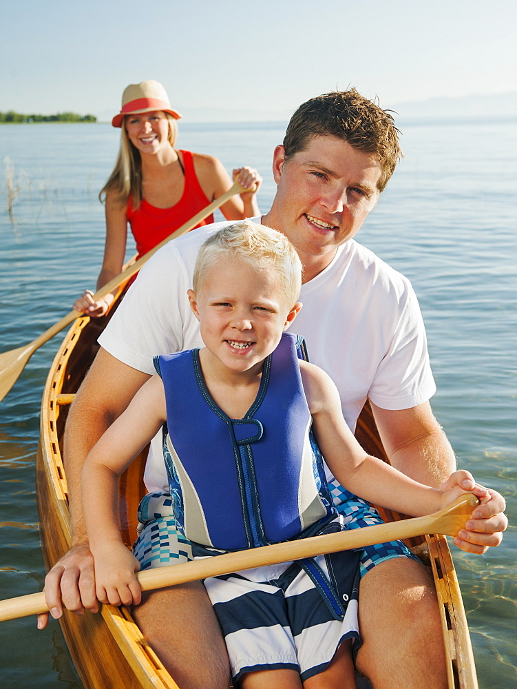 Portrait of family with son (4-5) canoe traveling