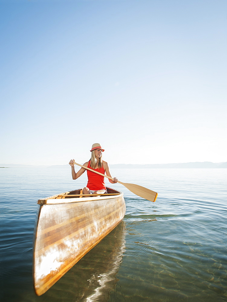 Portrait of young woman canoe traveling
