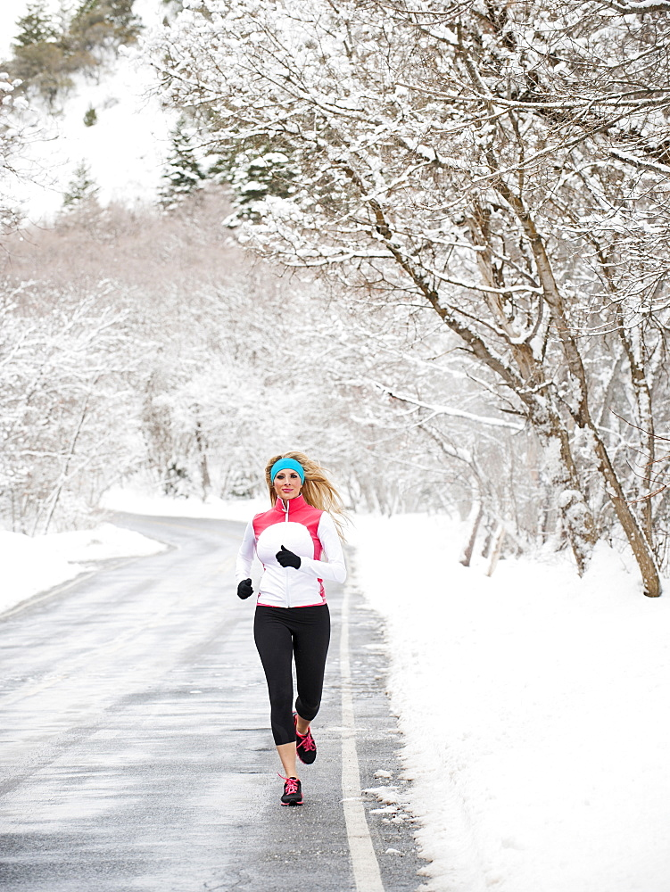 Woman jogging in winter, Salt Lake City, Utah USA - 1178-22979