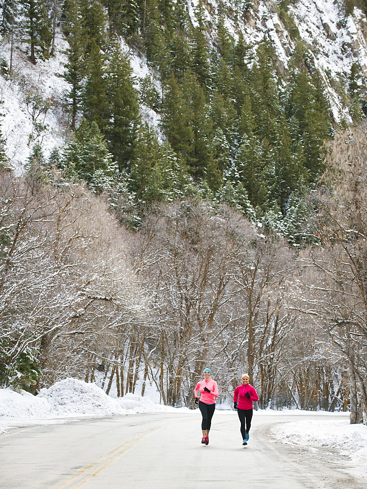 Two women jogging in winter, Salt Lake City, Utah USA