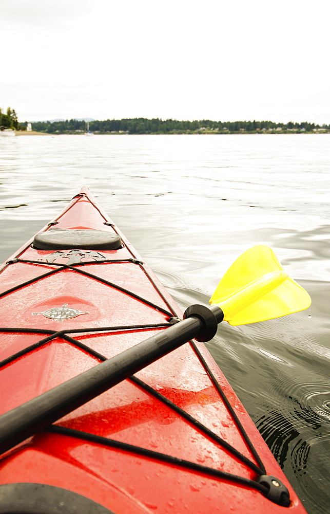 Kayaking on lake, Olympia, Washington, USA