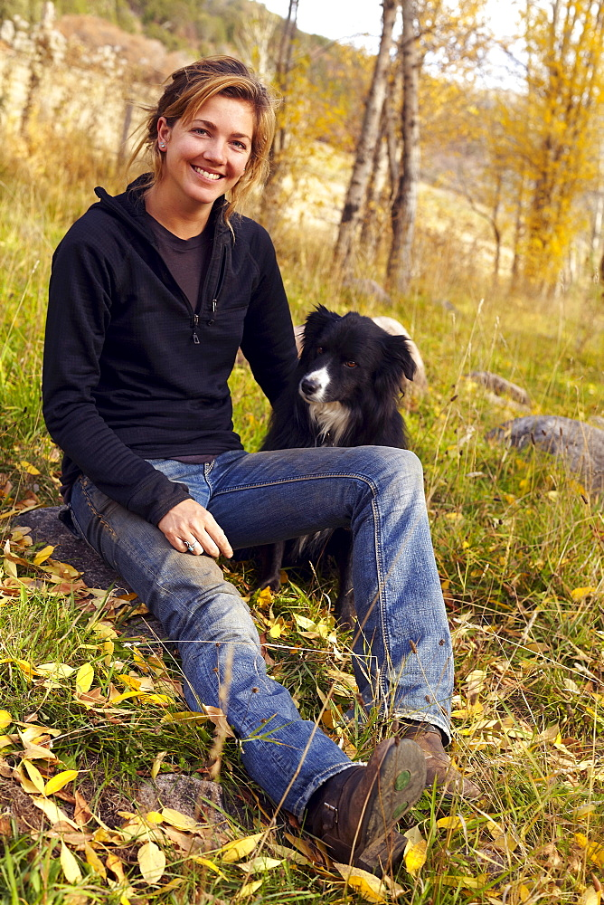 Portrait of woman with her collie outdoors, Colorado, USA