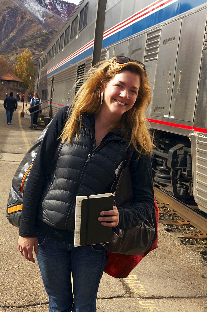 Woman smiling at train station, Glenwood Springs, Colorado, USA