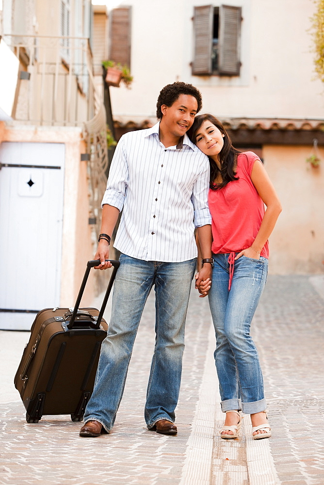 France, Cassis, Couple with suitcase holding hands, France, Cassis