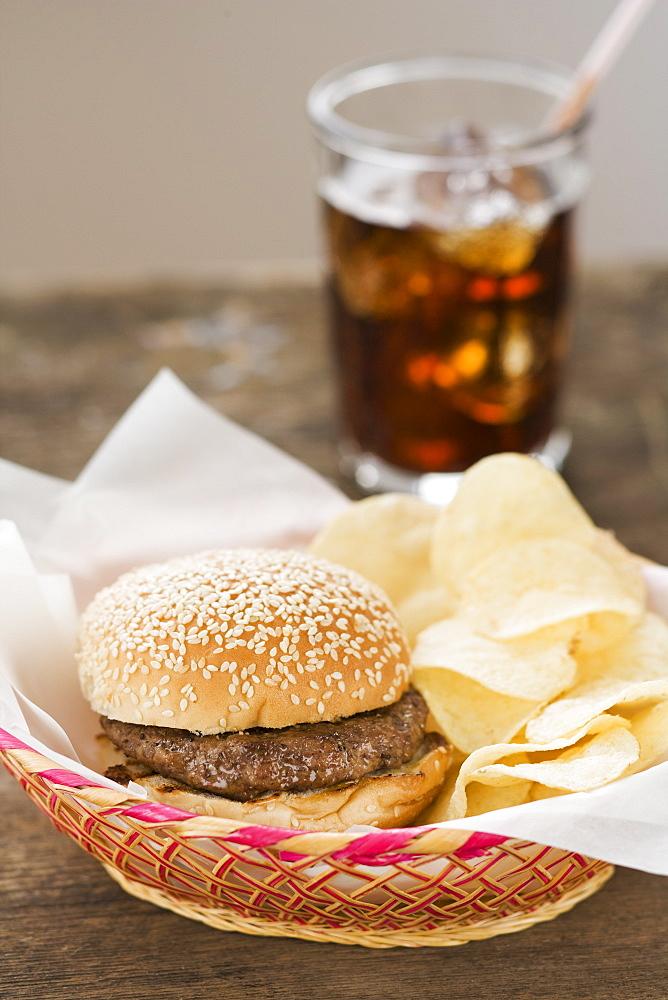 Hamburger and chips in basket