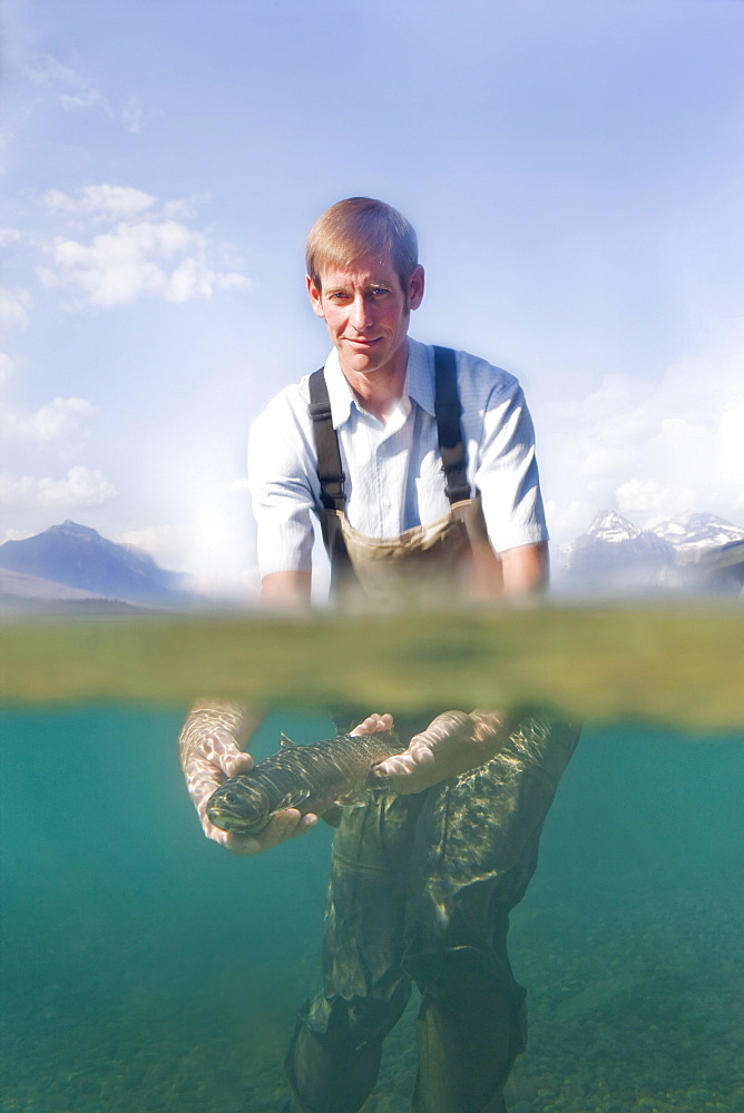 Man holding western cutthroat trout c, Lake McDonald, Glacier National Park, Montana, USA