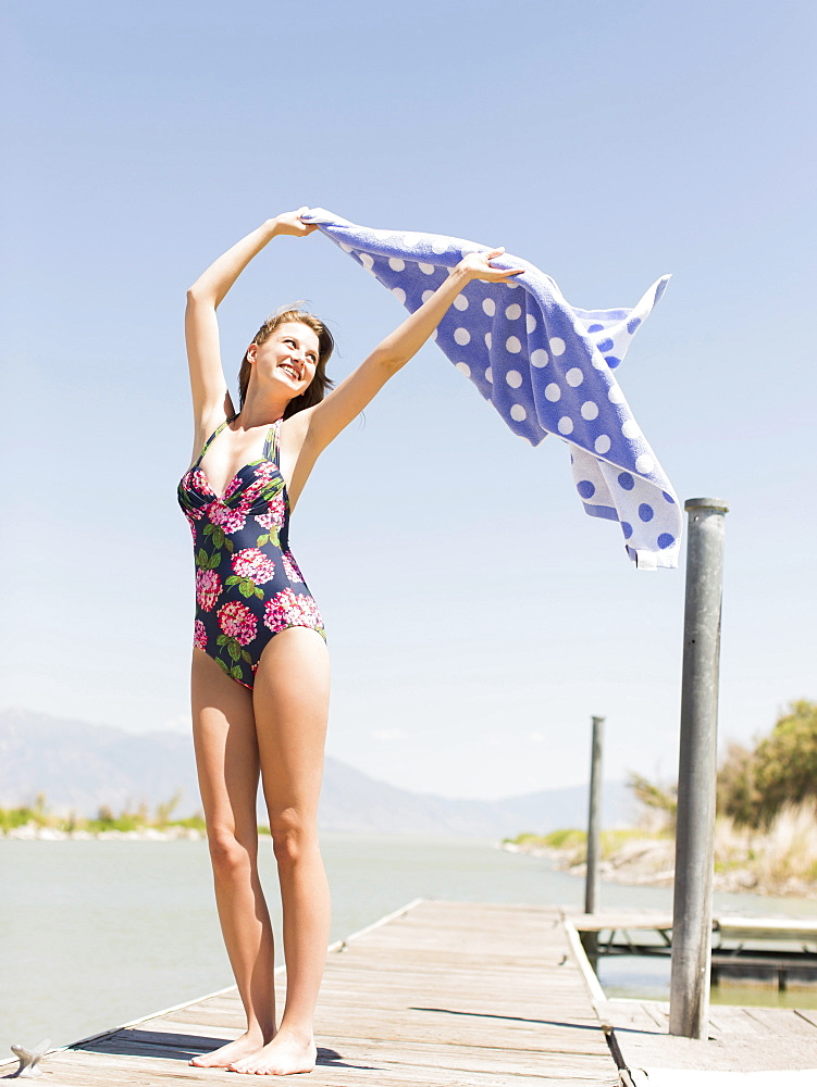 Woman wearing swimming costume standing on jetty, Salt Lake City, Utah, USA
