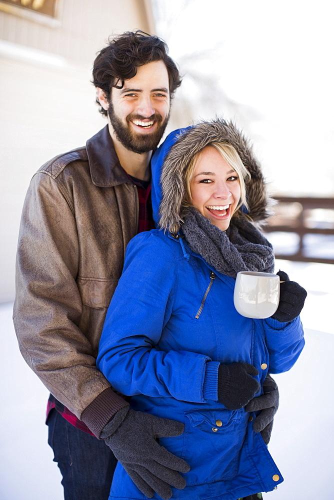 Portrait of happy couple in winter