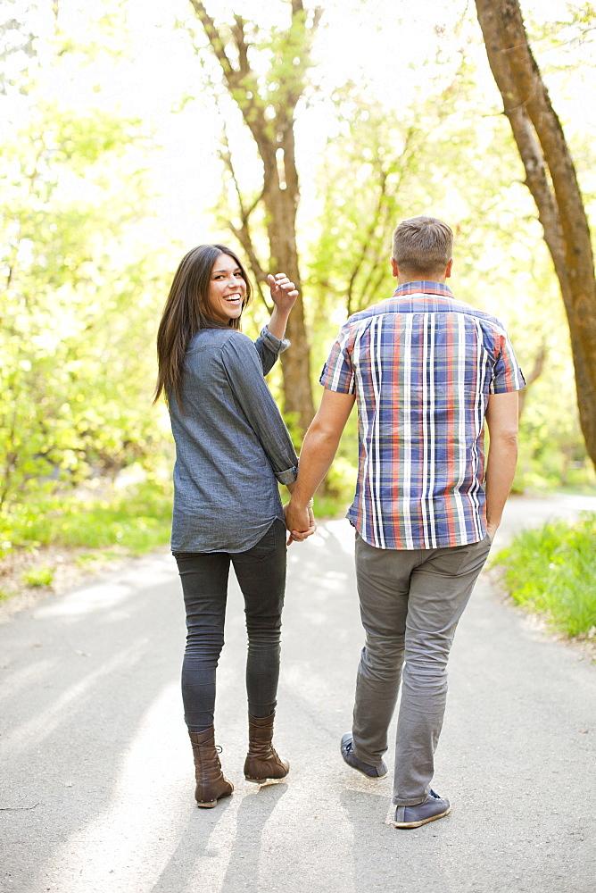 Young couple walking togetherness, USA, Utah, Salt Lake