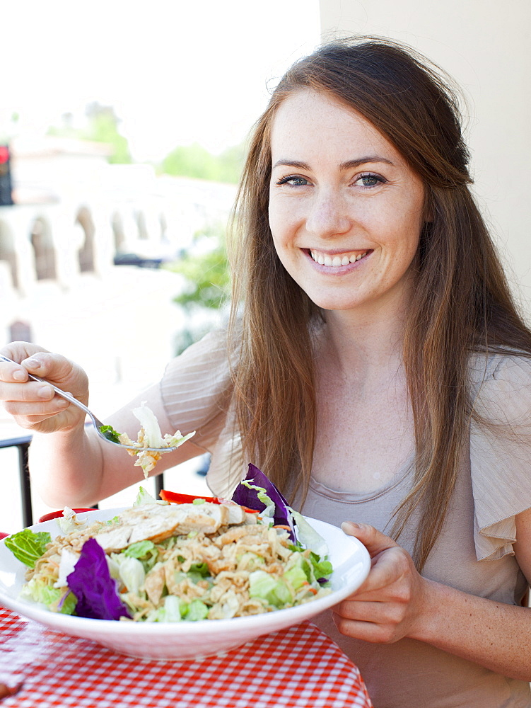 Portrait of young woman having salad, USA, Utah, Salt Lake