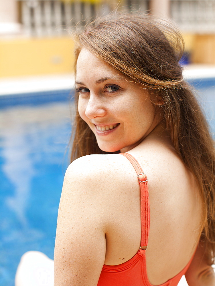 Portrait of young woman at swimming pool, USA, Utah, Salt Lake