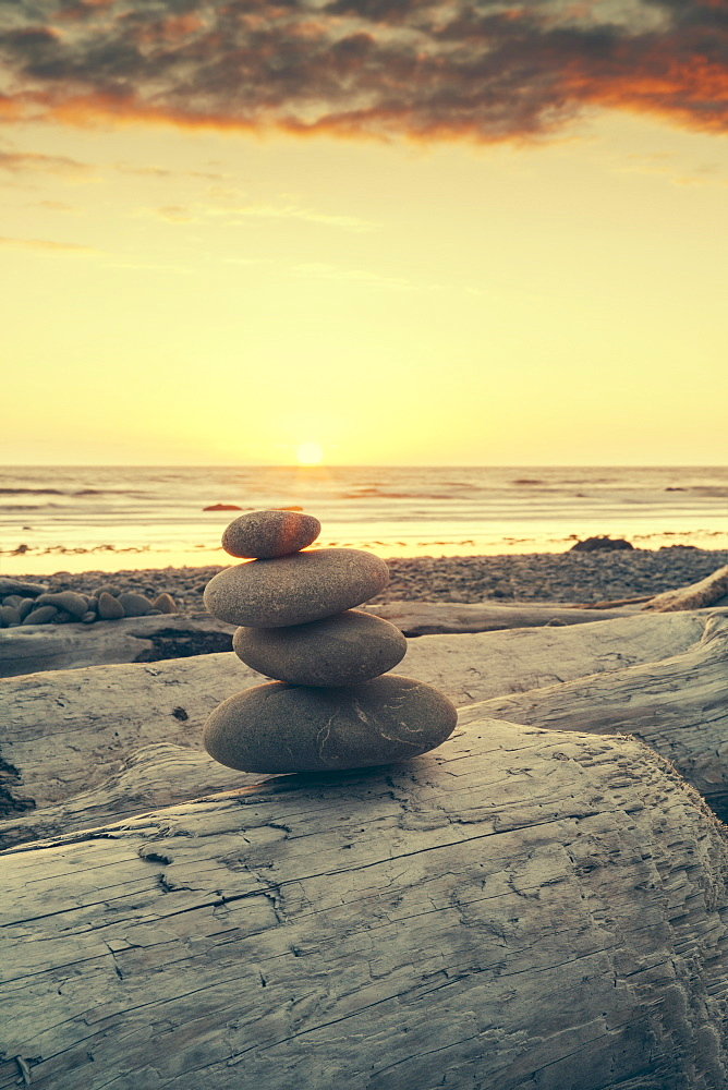 Stacked rocks on beach at sunset, Olympic National Park, Washington