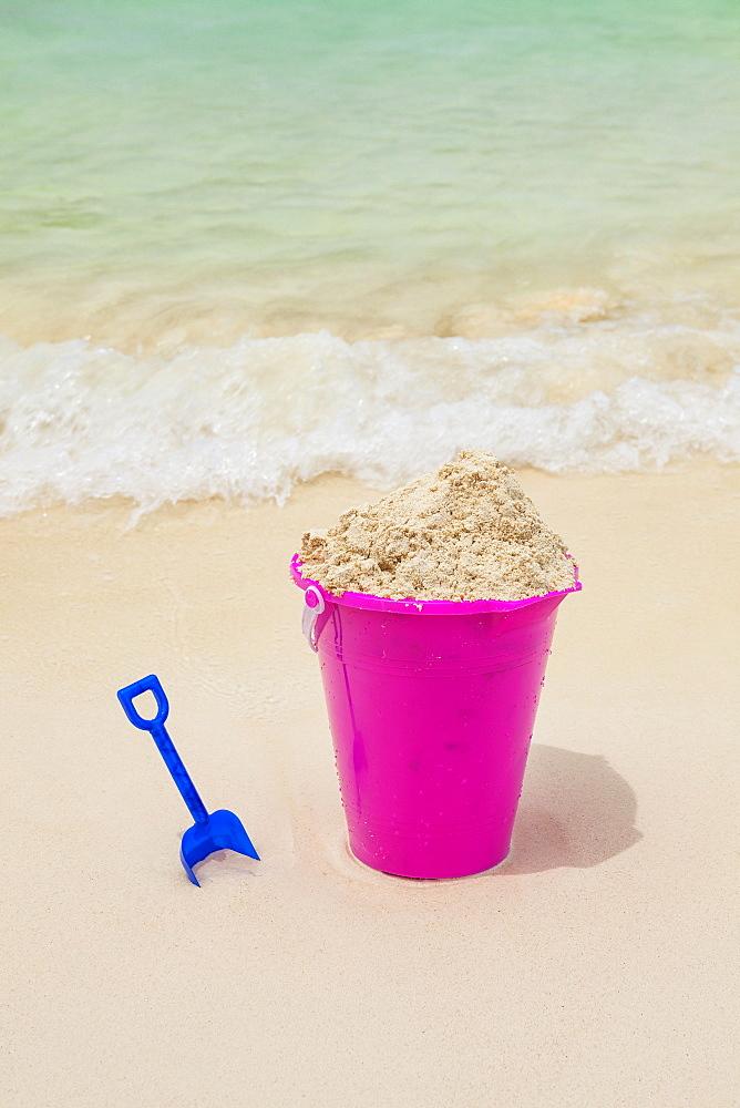 Sand pail and shovel on beach, Mexico, Quintana Roo, Yucatan Peninsula, Cancun