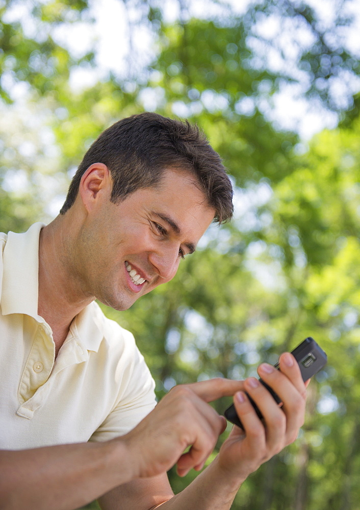 Portrait of man with mobile phone, USA, New Jersey, Mendham