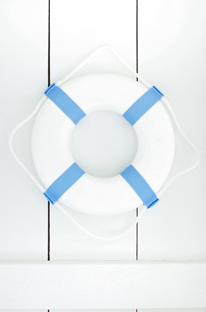 White lifebelt hanging on white wall