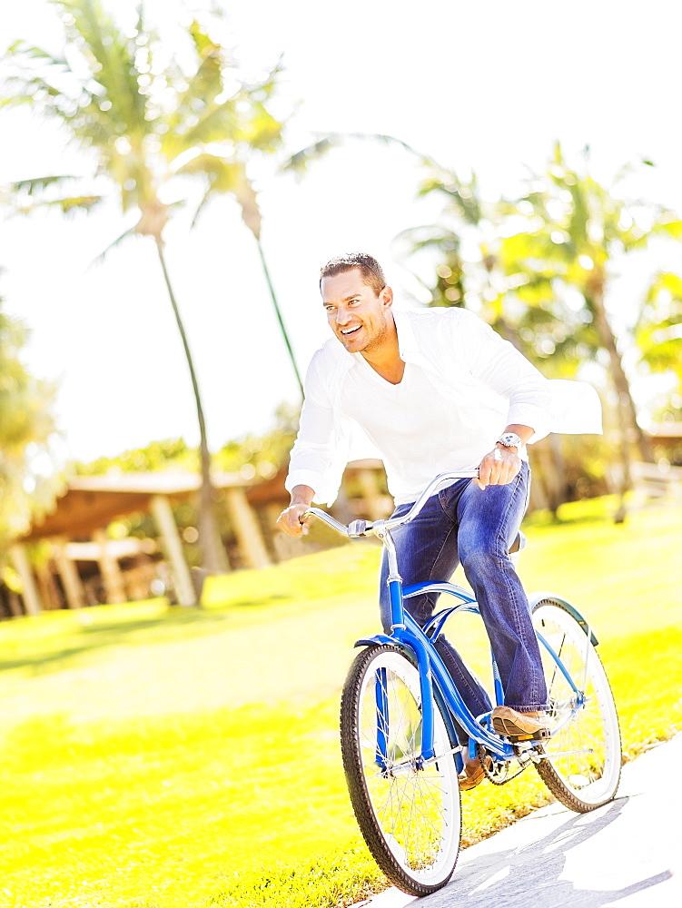 Man riding bike, Jupiter, Florida