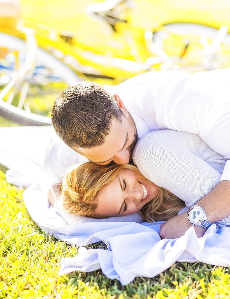 Couple lying down on blanket