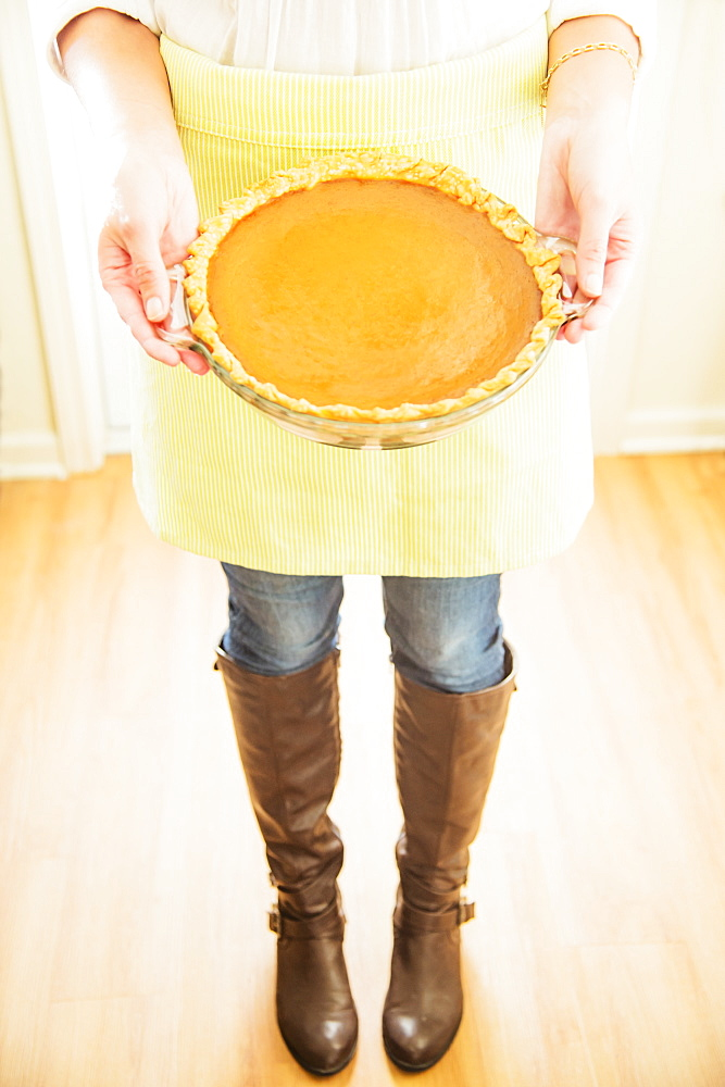 Woman holding pumpkin pie