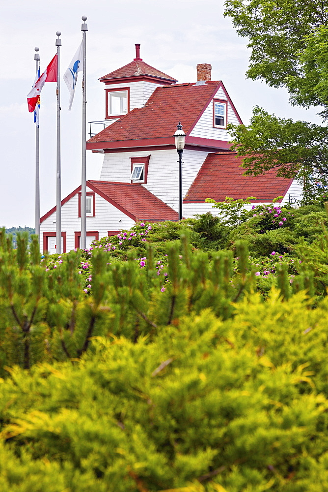 Fort Point Lighthouse and bushes in foreground, Nova Scotia, Canada
