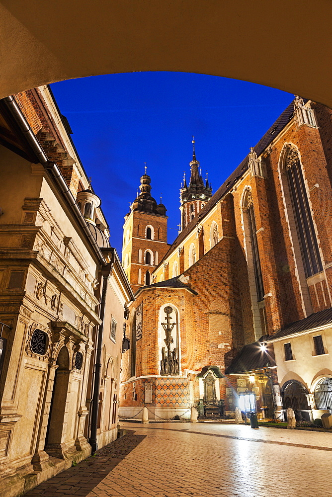Low angle view of St. Mary's Church and St. Barbara Church from under passage arch, Poland