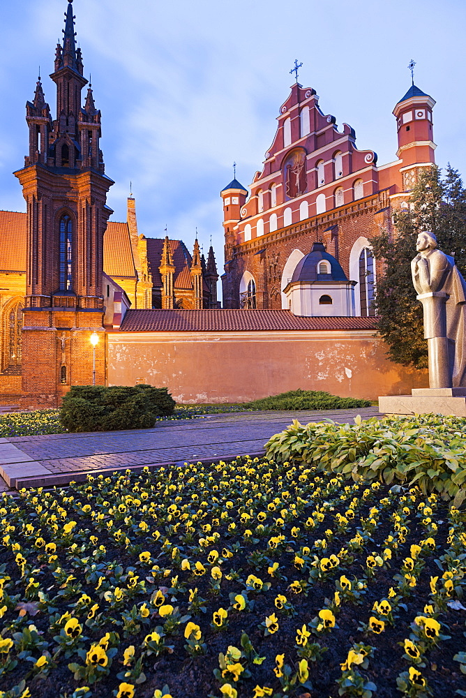 Saint Ann and Bernardine Churches at evening, flowers in foreground, Lithuania
