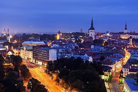 Elevated view of illuminated city at dusk, Tallin, Estonia