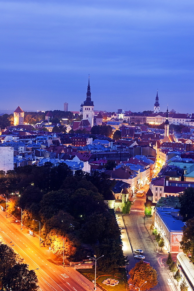 Elevated view of illuminated city at dusk, Tallin, Estonia