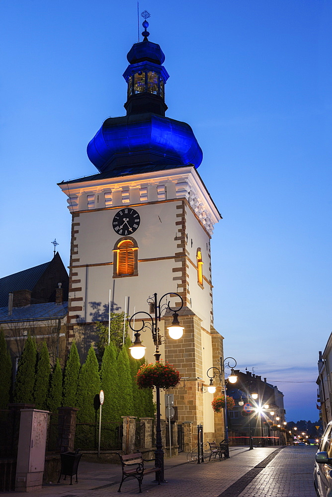 Bell Tower and empty sidewalk at night, Poland