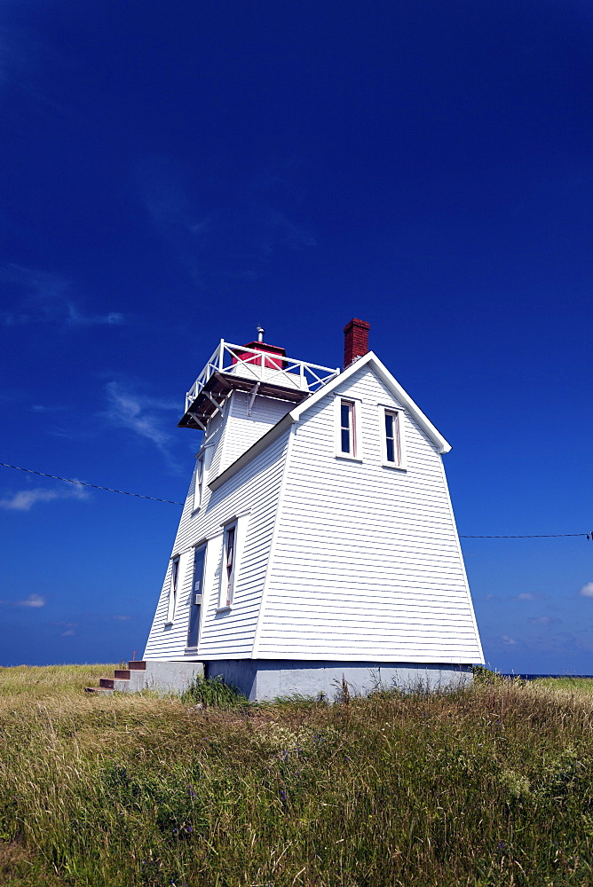 North Rustico Harbor Lighthouse against blue sky, Prince Edward Island, New Brunswick, Canada