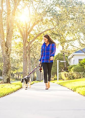 Woman walking her dog, Jupiter, Florida