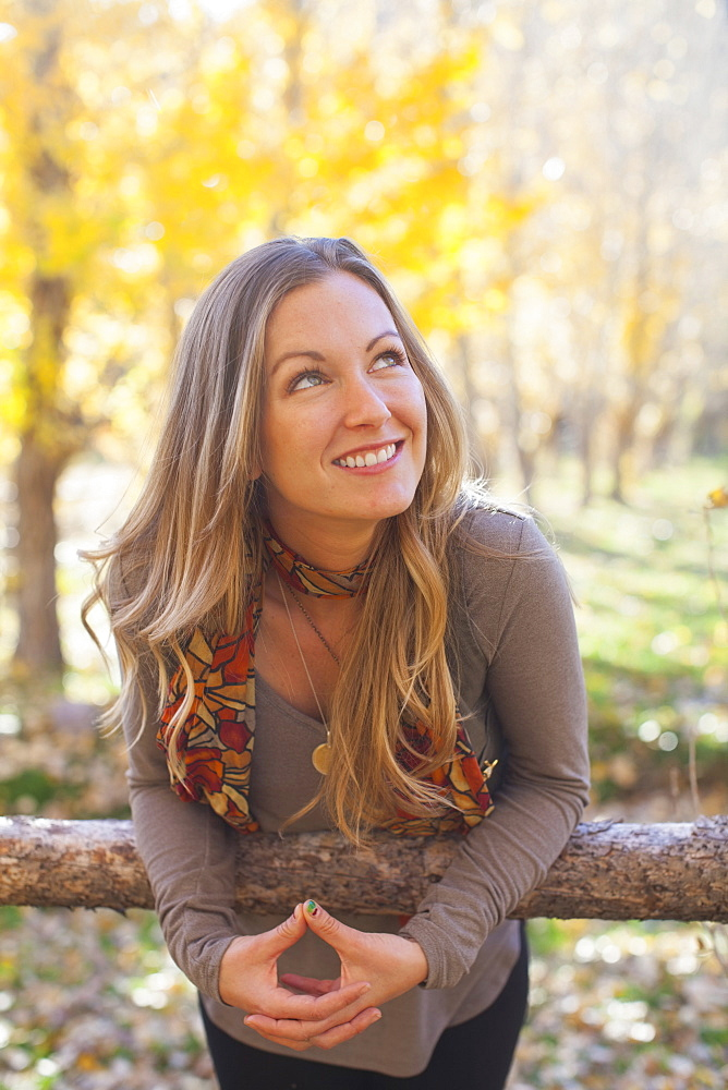 Portrait of smiling woman in forest, Colorado