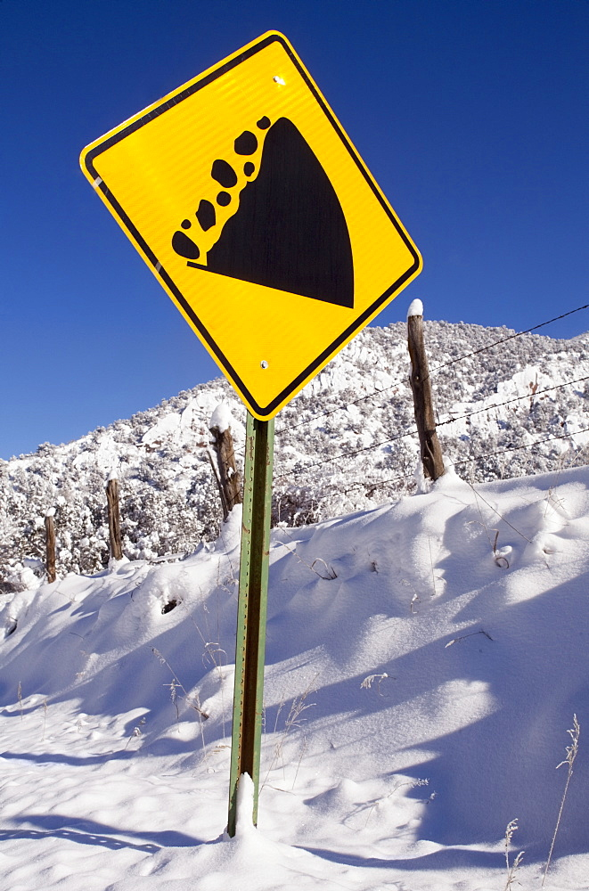 View of road sign and snowcapped mountain, Colorado
